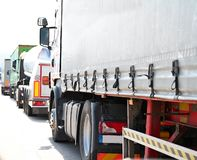 Lorries parked up outside a company. `s car parking area ready to deliver goods to customers royalty free stock photos