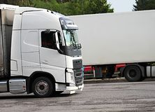 Lorries parked up outside a company`s car parking area. Image of lorries parked up outside a company`s car parking area stock photo