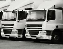 Lorries parked up outside a company. `s car parking area ready to deliver goods to customers royalty free stock photo