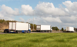 Lorries on the road Stock Photography
