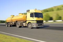 Lorry. The  lorry, Yellow,  quickly rushes on highway, on a background of the beautiful nature Stock Image