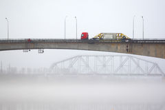 The lorry on the bridge in a fog Stock Photo