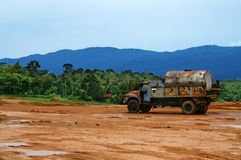 Lorry at Construction Site. A lorry carrying tank at construction site with water-logged surface Royalty Free Stock Photography