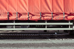 Lorry cover. Protective cover fastened on the back of a large freight lorry stock photography