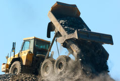Lorry delivering dumping rock Stock Images