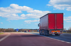 Lorry driving on motorway. Red lorry on motorway driving royalty free stock photography