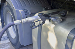 Lorry fill up with diesel. Refuelling diesel to lorry tank, large hose nozzle royalty free stock photography