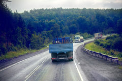 Lorry on highway-delivery of goods in bad weather threat. photo from the cab of a large truck on top Royalty Free Stock Image