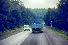 Lorry on highway-delivery of goods in bad weather threat. photo from the cab of a large truck on top Stock Photography