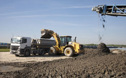 Lorry and loader and elevator Stock Photography