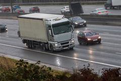 Lorry in motion. On the motorway in a bad rainy weather royalty free stock photo