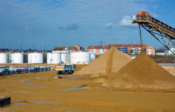 Lorry moving dockside sand  Stock Photography