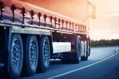 Lorry moving on sunny evening. Asphalt road with a truck. lorry moving on sunny evening stock images