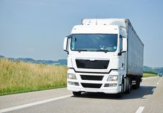 Lorry moving with trailer on lane. Logistic lorry truck with trailer driving on lane road delivering goods royalty free stock photography