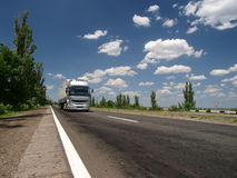 The lorry on a road. The lorry (truck) on a summer road stock photos