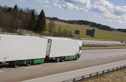 Lorry speeding away. Lorry, truck driving along on motorway, elevated view Royalty Free Stock Images