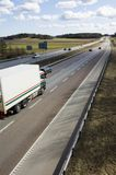 Lorry speeding into distance. Lorry ( slightly blurred ) driving into distance stock image
