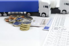 Lorry tachograph and money. Tachograph with lorry shows its good way to earn proper wage royalty free stock images