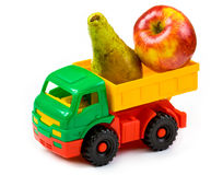 Lorry toy with a pear and an apple Royalty Free Stock Images