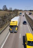 Lorry with traffic. Lorry driving with surrounding traffic Royalty Free Stock Images