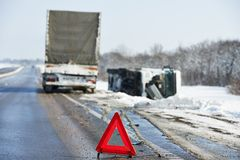 Winter car crash. Lorry trailer car crash smash accident on an slippery winter snow interstate road stock images