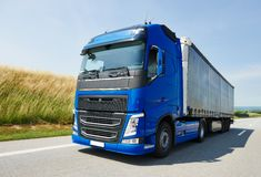 Lorry with trailer driving on highway Stock Image