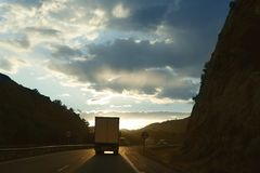Lorry truck backlight on a golden Europe road. Evening royalty free stock photos