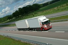 Lorry, truck on highway. White, clean lorry, truck driving along highway in the countryside Royalty Free Stock Photos