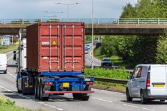 Lorry truck with intermodal container on uk motorway in fast motion.  royalty free stock photos