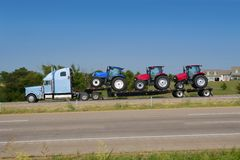 Lorry truck transport with agriculture tract. Lorry truck transport with three agriculture tractor Stock Photo