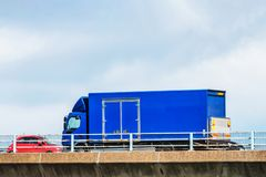Lorry truck on uk motorway ober cloudy sky background.  royalty free stock photo