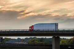 Lorry on the viaduct. Lorry in motion on the viaduct during sunset stock images