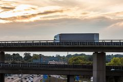 Lorry on the viaduct. Lorry in motion on the viaduct during sunset stock photography