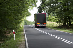 Lorry on village road Royalty Free Stock Images