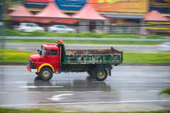 Lorry on wet road in a rainy day. Stock Photos