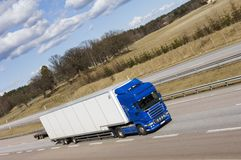 Lorry with wide-angle view. Lorry speeding on motorway, elevated view Stock Images