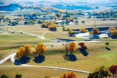 Los árboles del otoño en el prado Imágenes de archivo libres de regalías