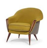 Los años 60 retros de la silla del estilo diseñan o miran el amarillo antiguo c de la mostaza Imagen de archivo libre de regalías