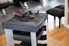 Los accesorios de los peluqueros foto de archivo