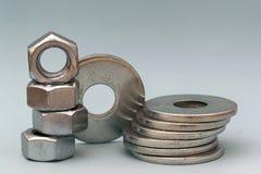 Los accesorios del carpintero Pilas de ISO de las lavadoras y de las nueces del tornillo de metal Fotografía de archivo libre de regalías