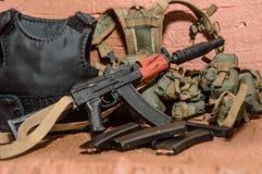 Los accesorios para el foco selectivo de los soldados disparan contra el juguete Foto de archivo