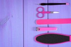 Los accesorios para la manicura o pedicura, concepto de pie, mano y clavo cuidan, copian el espacio para el texto Imagen de archivo libre de regalías