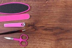 Los accesorios para la manicura o pedicura, concepto de pie, mano y clavo cuidan, copian el espacio para el texto Imagenes de archivo