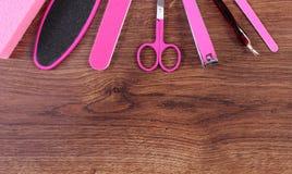 Los accesorios para la manicura o pedicura, concepto de pie, mano y clavo cuidan, copian el espacio para el texto Fotografía de archivo libre de regalías