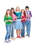 Los adolescentes brillantes y felices están aplaudiendo Foto de archivo libre de regalías