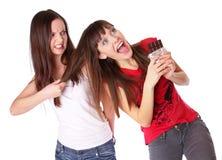 Los adolescentes están luchando para el chocolate Foto de archivo