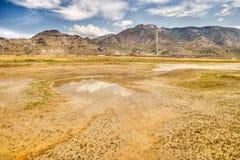Los altos llanos abandonan y las montañas Fotografía de archivo