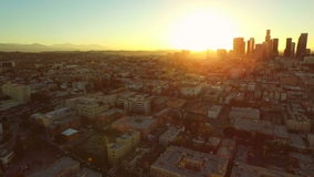 Los Angeles Aerial Downtown Cityscape Sunrise. V88 Low flying turning aerial revealing downtown cityscape at sunrise stock video footage