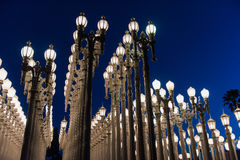LOS ANGELES, CA - April 25, 2016: 'Urban Light' is a large-scale assemblage sculpture by Chris Burden at the LACMA. LOS ANGELES, CA - April 25, 2016: 'Urban Stock Photography
