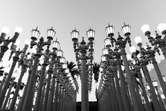 LOS ANGELES, CA - April 25, 2016: 'Urban Light' is a large-scale assemblage sculpture by Chris Burden at the LACMA. LOS ANGELES, CA - April 25, 2016: 'Urban Royalty Free Stock Images